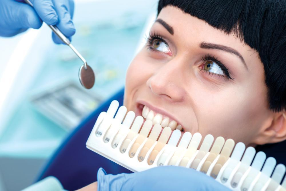 Woman getting teeth whitened | Dentist Edmonton AB