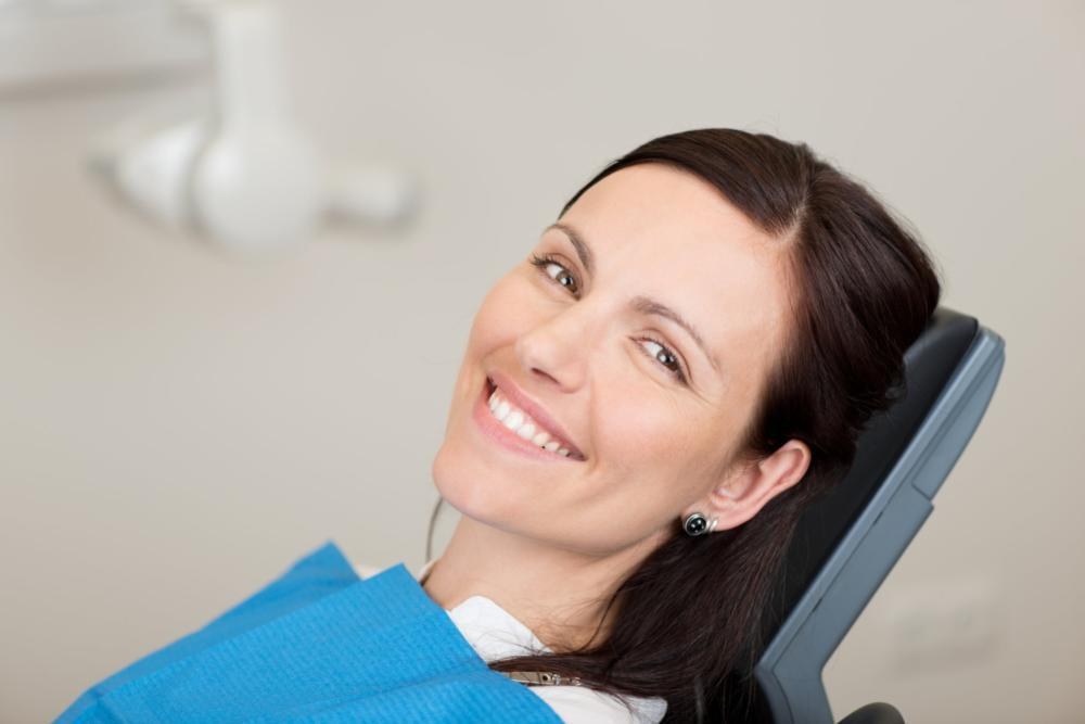 Woman smiling in dental chair | Dentist Edmonton AB