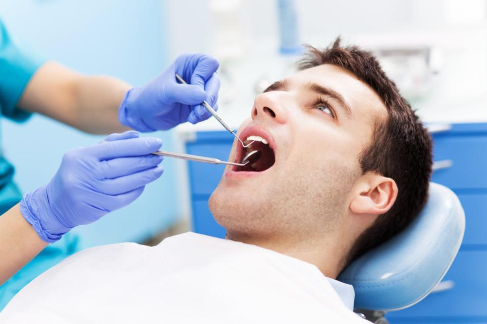 Man sitting in dental chair | Dentist Edmonton AB